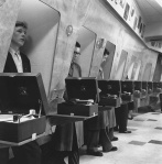 Soundproof listening booth at a London music store 1955